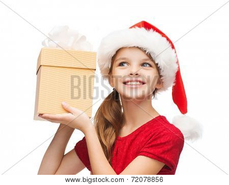 christmas, x-mas, winter, happiness concept - smiling girl in santa helper hat with gift box