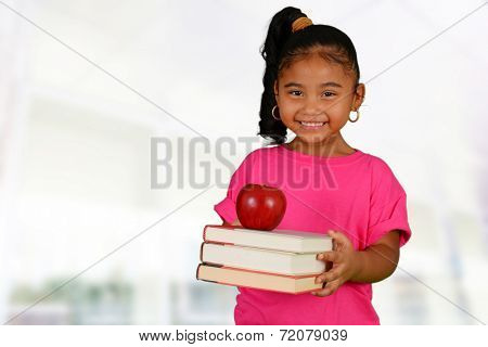 Young girl holding her books before school