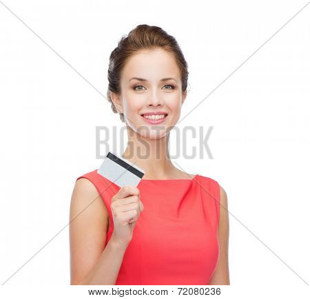 fashion, shopping, banking and payment concept - smiling elegant woman in red dress with plastic credit card