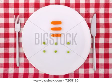 Tablecloth With Fork, Knife, Six Peas And Three Carrotts On The Plate