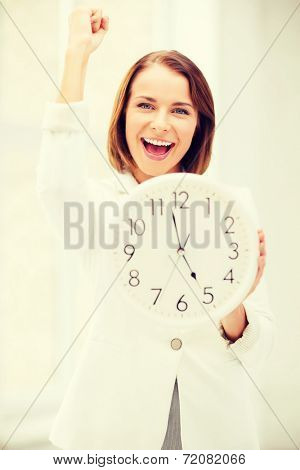 business, office and time management concept - attractive businesswoman with clock