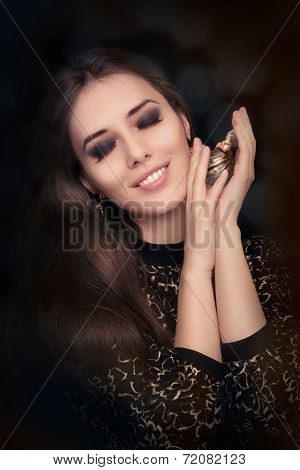 Retro glamour woman holding vintage perfume bottle