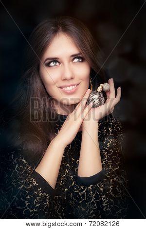 Retro glamour woman holding vintage perfume bottle