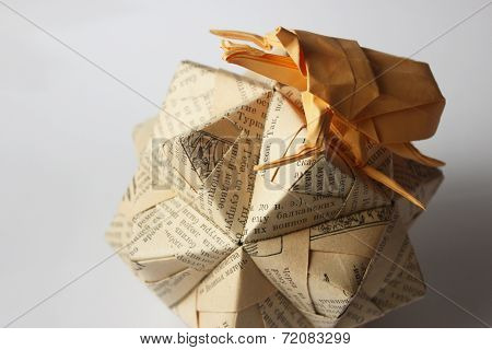 Origami Bug Climbing Over Cyrillic Sphere