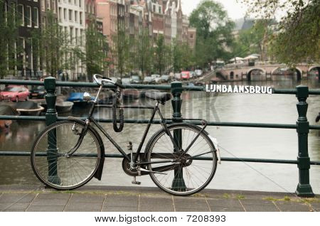 Bike Parked On A Bridge