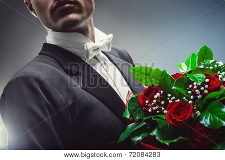 Young man with a bouquet of flowers