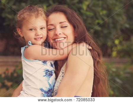 Happiness. Mother And Kid Girl Cuddling Outdoors Summer Background. Instagram Effect Portrait