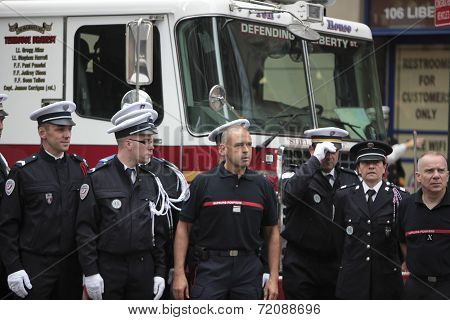 French fire fighters & police pose