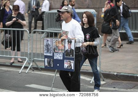 WTC victim relatives with memorial signs