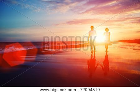 Couple walking on the beach, man and woman in romantic vacation