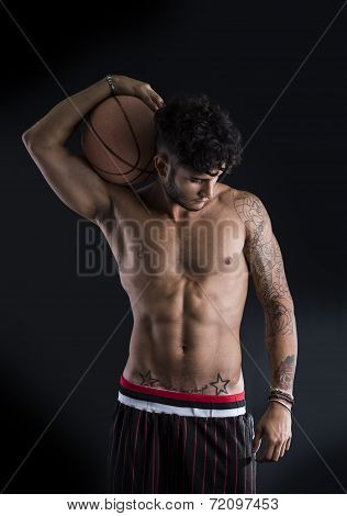 Young Athletic Man On Dark Background Holding Basketball Ball