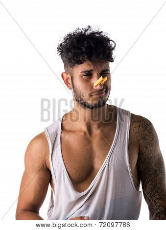 Young Man With Clothespin On His Nose - Bad Smell Concept