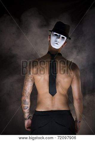 Shirtless Man Dancer Or Actor With Creepy, Scary Mask At Back Of His Head