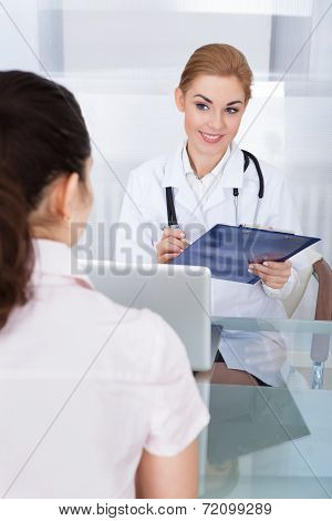 Female Doctor Talking With Patient