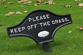 image of manicured lawn  - Painted iron sign with the message Please Keep off the Grass stuck in a well manicured lawn - JPG