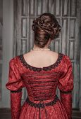 foto of pompous  - Portrait of young beautiful medieval woman in red dress back - JPG