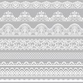 stock photo of lace  - Set of white lace borders isolated on gray background - JPG
