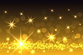 stock photo of christmas theme  - Gradient Yellow Sparkling Starburst Christmas Themed Background - JPG