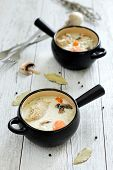 picture of veal  - Two pots with veal and cream sauce - JPG
