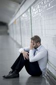 Постер, плакат: Young Businessman Lost In Depression Sitting On Ground Street Subway