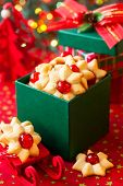 stock photo of christmas cookie  - Christmas cookies with red candied cherries in the green gift box - JPG