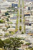 image of gey  - Aerial view of Market street in the Castro San Francisco California United States of America. View of the avenue LGBT rainbow flag waving cityscape and Castro area from Twin Peaks.