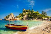 picture of boat  - small boat for excursion in front of the island Isola Bella at Taormina Sicily - JPG