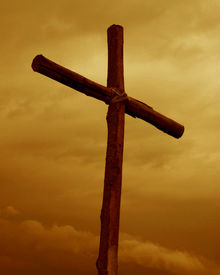 picture of christian cross  - lone wooden cross against cloudy orange sky - JPG