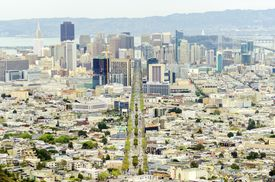 stock photo of chola  - Aerial view of downtown San Francisco city skyline California United States of America. A view of Market street in the Castro LGBT rainbow flag cityscape skyscrapers architecture and bay from Twin Peaks.