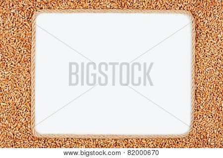 Frame Made Of Rope With  Wheat Lying On A White Background