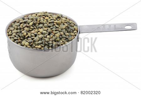 Marbled Dark Green Lentils In A Cup Measure