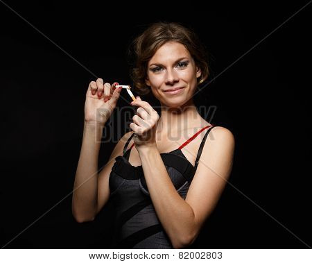 Happy Young Woman With The Broken Cigarette.