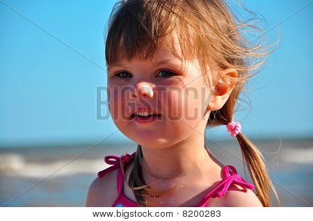cute little girl against the sky