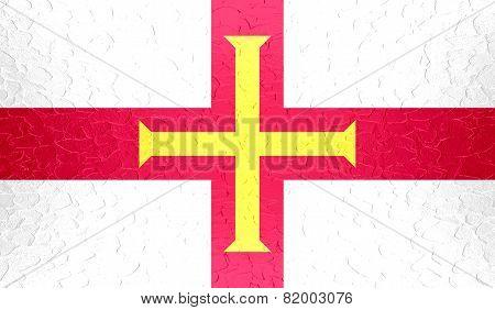 Guernsey flag on metallic metal texture