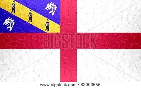 Herm flag on metallic metal texture