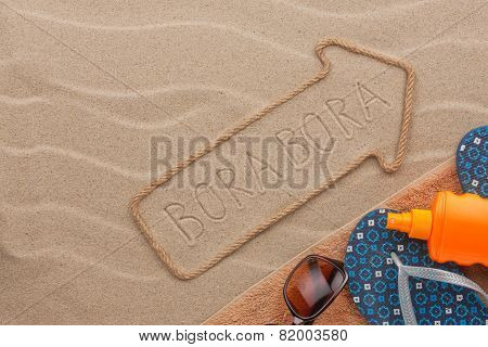 Bora Bora  Pointer And Beach Accessories Lying On The Sand
