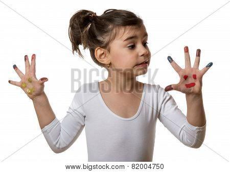 Portrait Of A Cute Cheerful Girl Showing Her Painted Hands