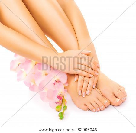 Relaxing manicure and pedicure with a pink orchid flower