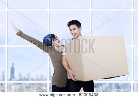 Excited Couple Bring Box At New Apartment