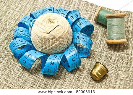 Thimble, Yarn And Spools Of Thread