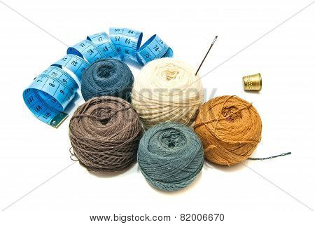 Different Balls Of Yarn And Thimble