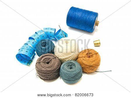 Balls Of Yarn And Thimble