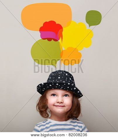 Dreaming Kid Girl In Hat Smiling And Looking Up On Many Colorful Bubbles