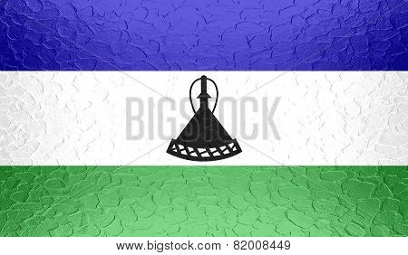 Lesotho flag on metallic metal texture