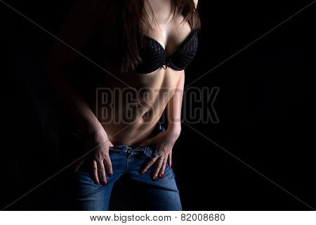 Image of young woman in jeans