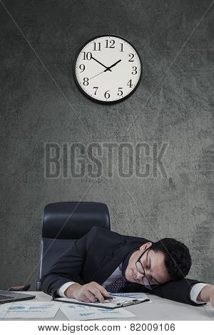 Overworked Manager Sleeping On Desk