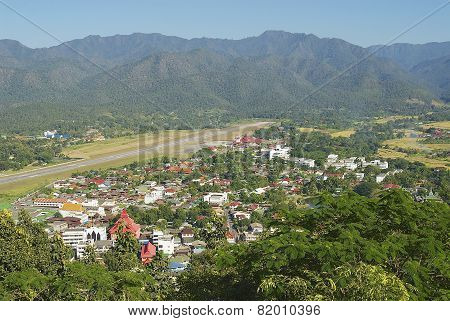 View to the airport stripe and town of Mae Hong Son, Thailand.