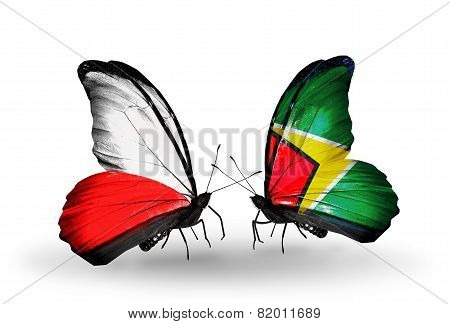Two Butterflies With Flags On Wings As Symbol Of Relations Poland And Guyana