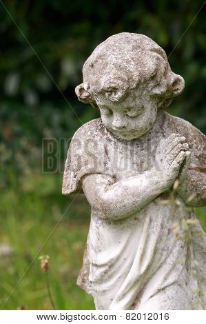 Stone praying child