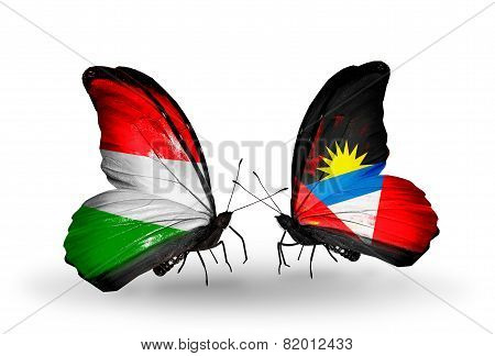 Two Butterflies With Flags On Wings As Symbol Of Relations Hungary And Antigua And Barbuda